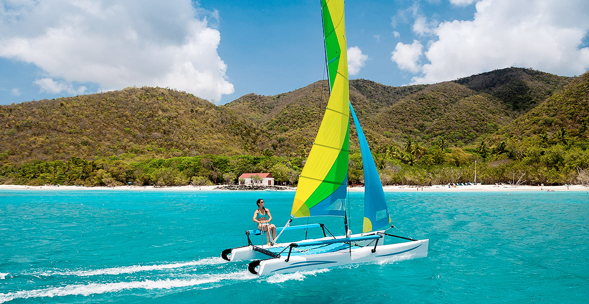 woman sailing a catamaran in Cinnamon Bay, St.John, USVI
