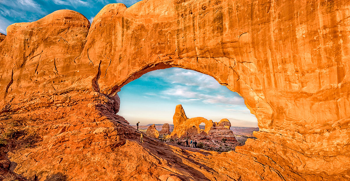 Turret Arch through North Window at sunrise at Arches National P