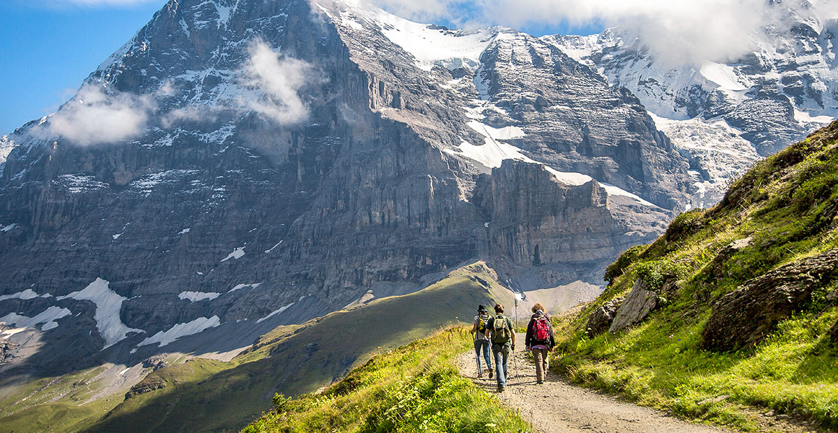 19457_SWIT_stock-photo-hikers-on-the-the-eiger-trail-and-the-eiger-a-metre-ft-mountain-of-the-bernese-alps-772878226