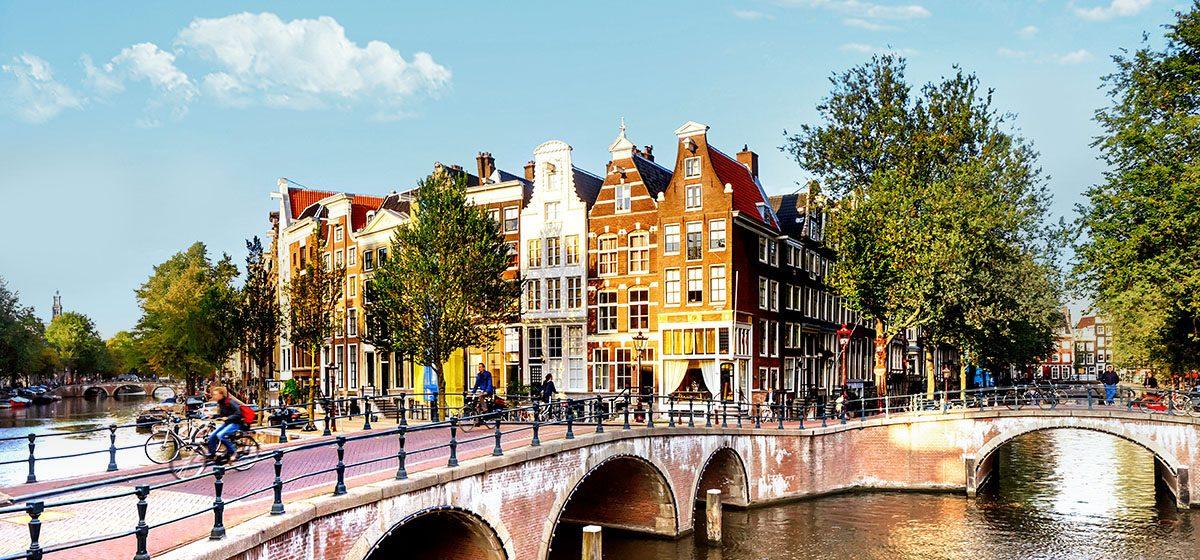 21421_CC_Amsterdam_Canals_Golden_Sunlight_Tall_Clouds